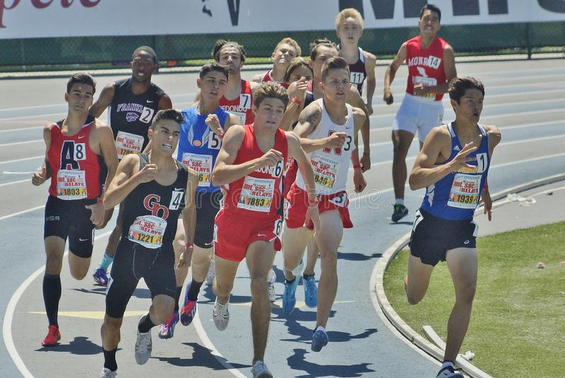 Mens Mile run at the 2016 Mt. Sac Relays. Mt. Sac relays 2016 track and field meet, Men's mile run This year at Cerritos Jr. College. Next year back to Mt. San stock photos