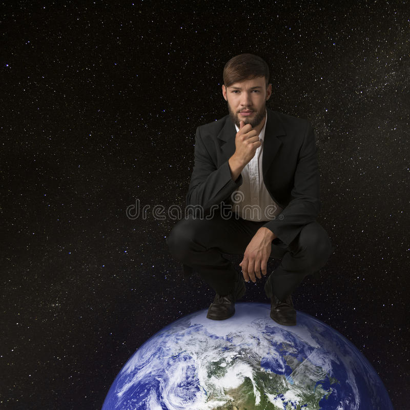 Mens op aarde stock afbeeldingen