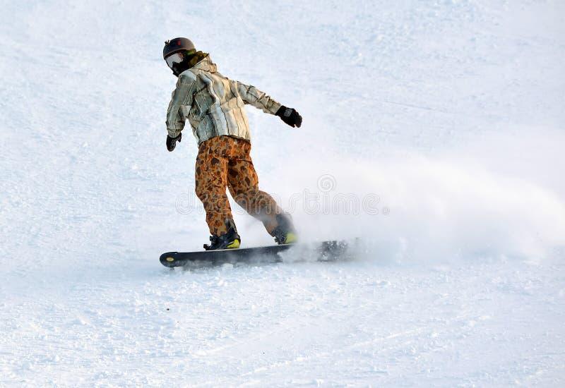 Mens op snowboard royalty-vrije stock foto