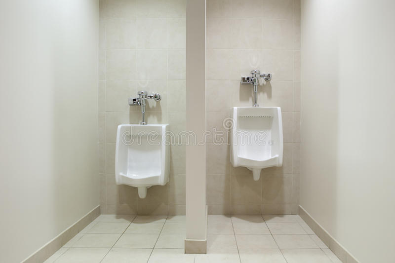 Download Mens Restroom - Urinals stock image. Image of pipe, water - 24657867