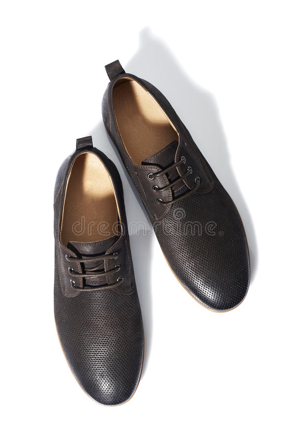 Mens Shoes. Studio shot of brown mens shoes on white background royalty free stock photography