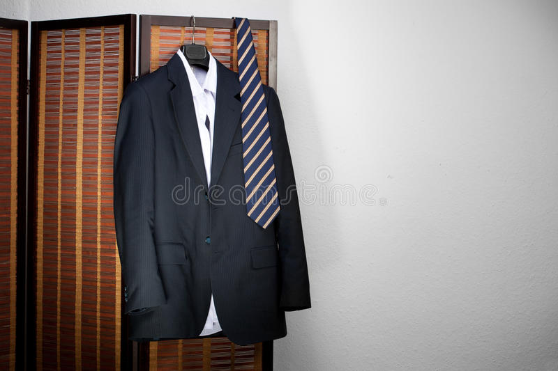 Mens Suit Hanging On Hangers Royalty Free Stock Images
