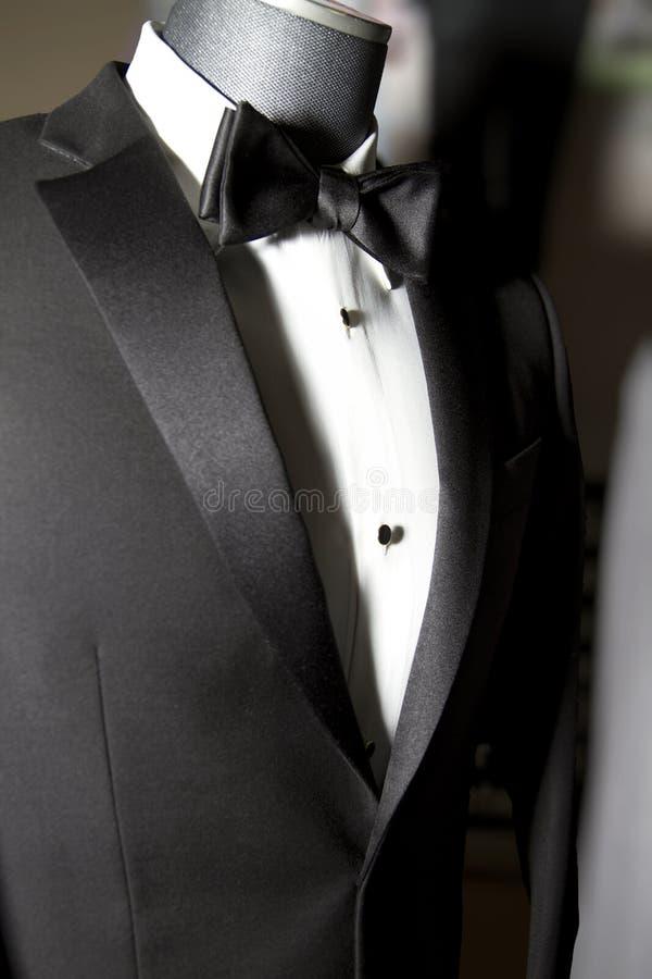Mens Tuxedo coat and tie. Black mens tuxedo coat jacket with black bow tie and white shirt royalty free stock photography
