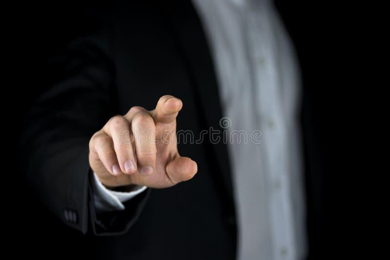 Mens wat betreft een virtuele interface met zijn vinger stock foto