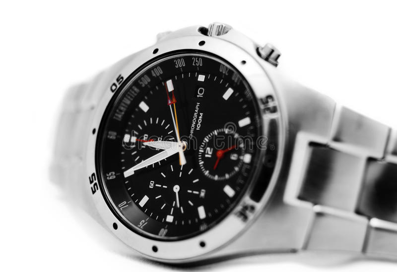 Mens watch. Close up of a modern mens watch isolated againts white royalty free stock images