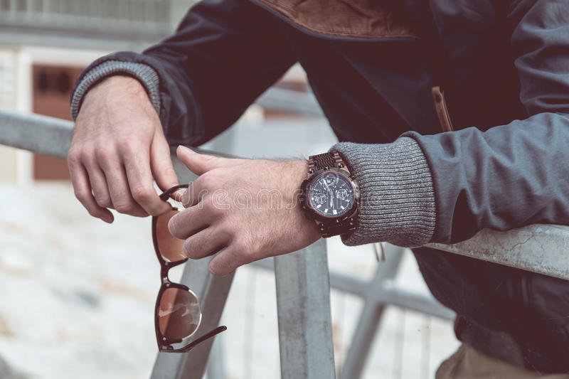 Mens watch on hand stock photography