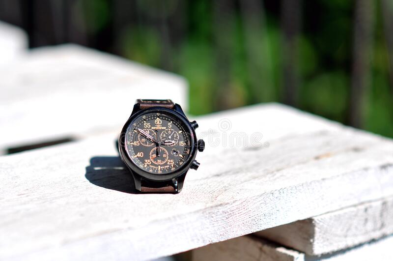 Mens watch on wood stock photography