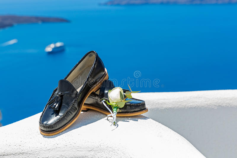 Mens wedding shoes. On blue sea background stock image