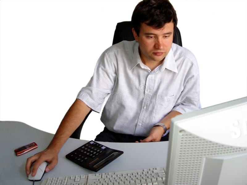 Mens In Zijn Bureau Stock Foto
