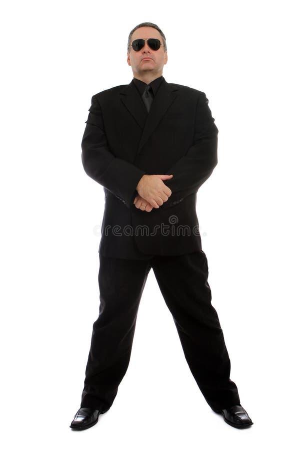 Mens in zwart kostuum royalty-vrije stock fotografie