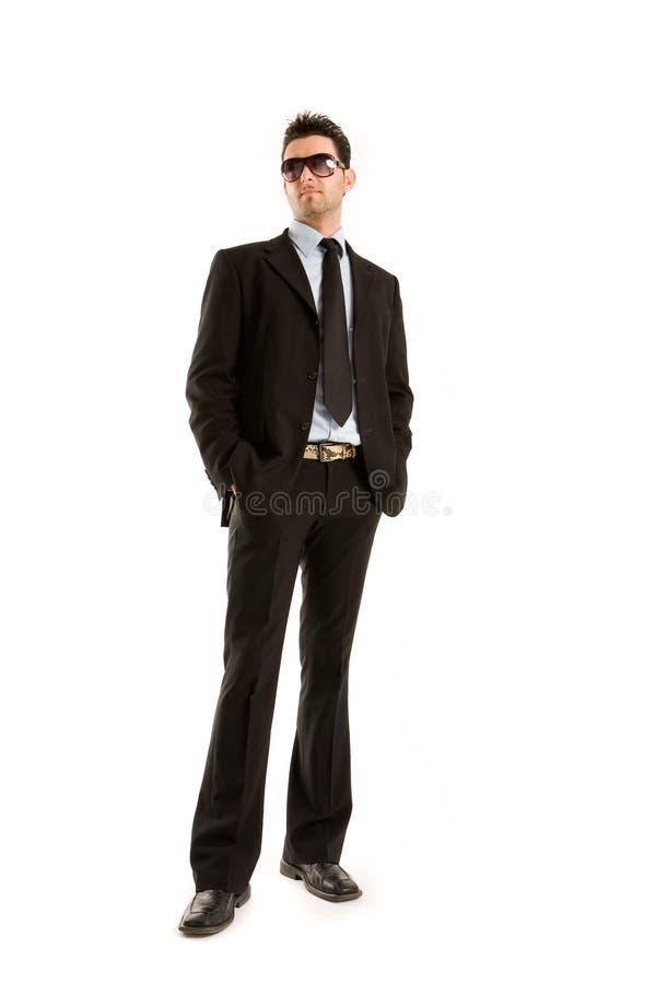 Mens in zwarte met zonnebril royalty-vrije stock afbeelding