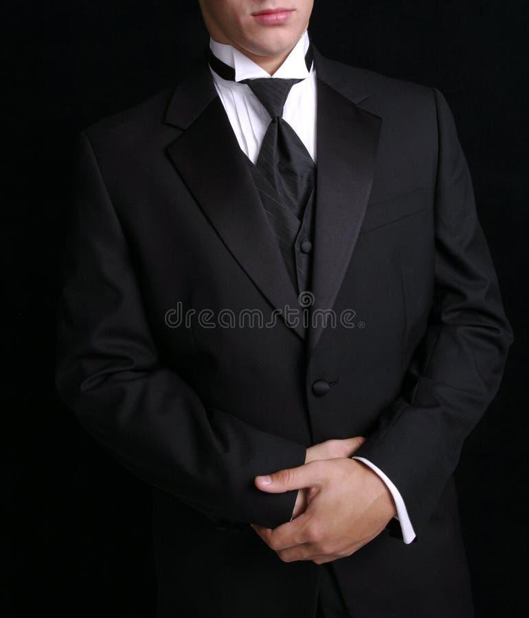 Mens in Zwarte Tux stock foto's