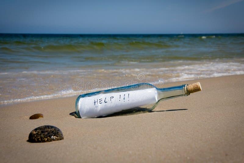 Mensagem da ajuda no frasco fotografia de stock