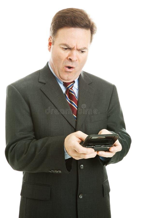 Mensagem de texto ofensiva - homem de negócios foto de stock