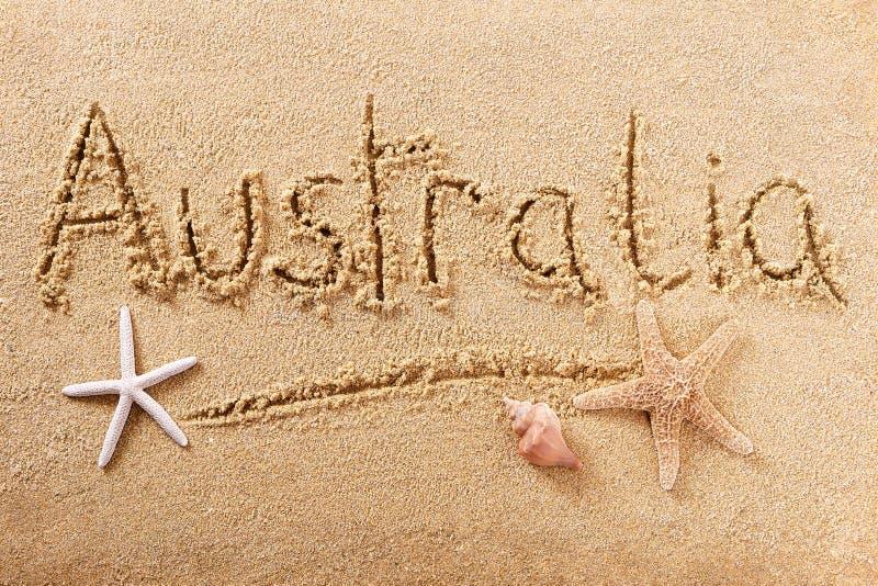 Mensagem escrita à mão da areia da praia de Austrália imagens de stock royalty free