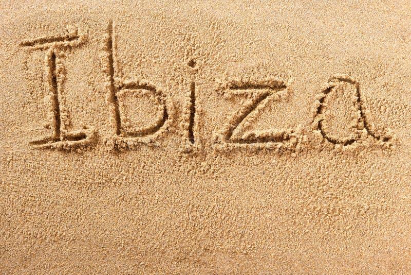 Mensagem escrita à mão da areia da praia da Espanha de Ibiza imagem de stock