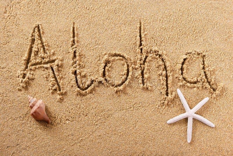 Mensagem escrita à mão do cumprimento da areia da praia de Aloha Hawaii fotografia de stock royalty free