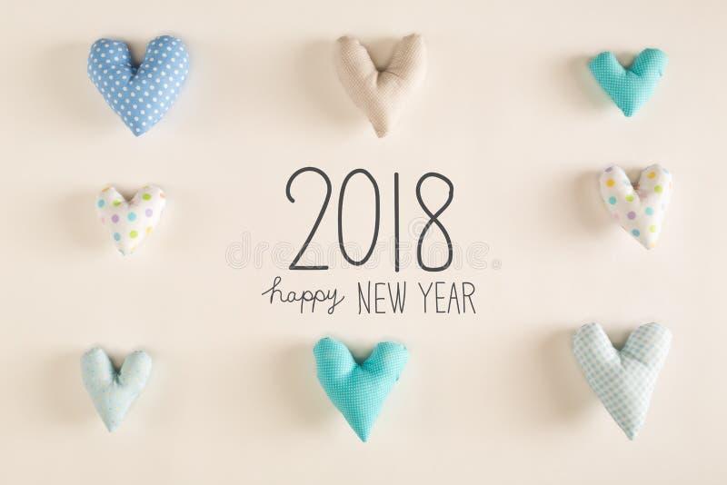 Mensaje 2018 de la Feliz Año Nuevo con los amortiguadores azules del corazón imagen de archivo