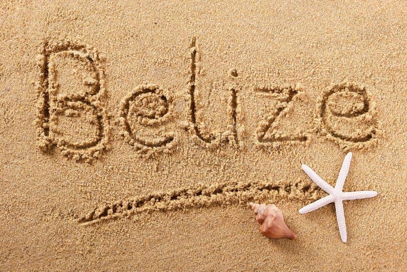 Mensaje de la muestra de la arena de la playa de Belice foto de archivo libre de regalías