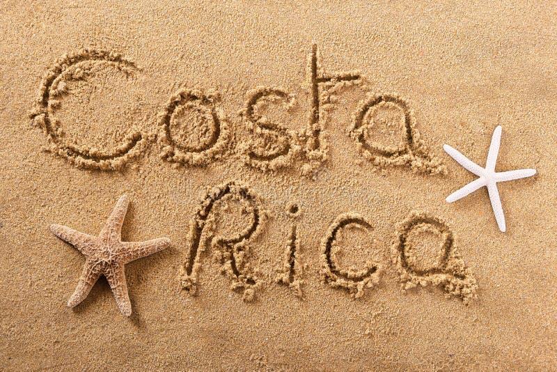 Mensaje de la muestra de la arena de la playa de Costa Rica fotos de archivo