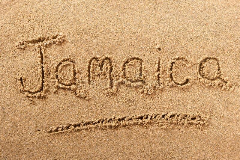 Mensaje de la muestra de la arena de la playa de Jamaica imagenes de archivo