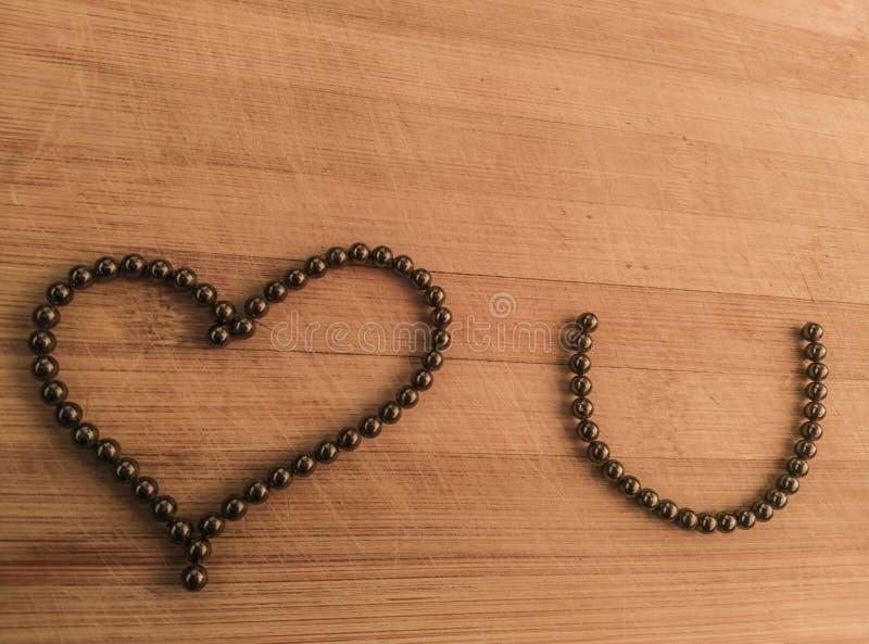Mensaje del amor en fondo de madera fotos de archivo libres de regalías