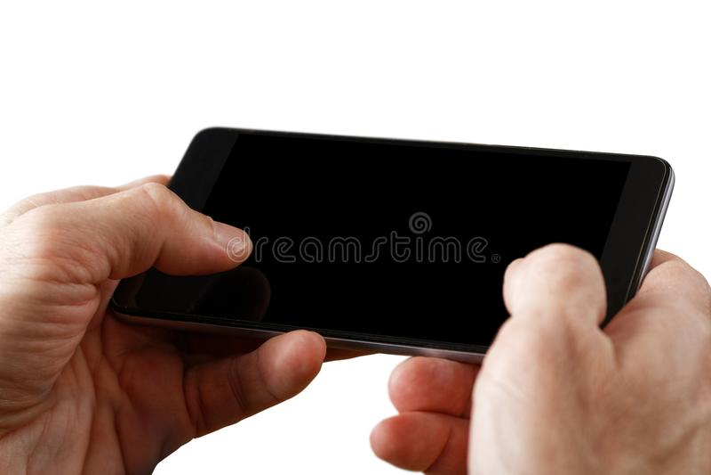 Menschliche Hände der Nahaufnahme, die Smartphone halten stockbilder