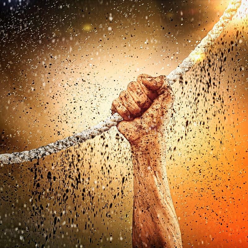 Menschliche Hand, die Seil hält stockfotos