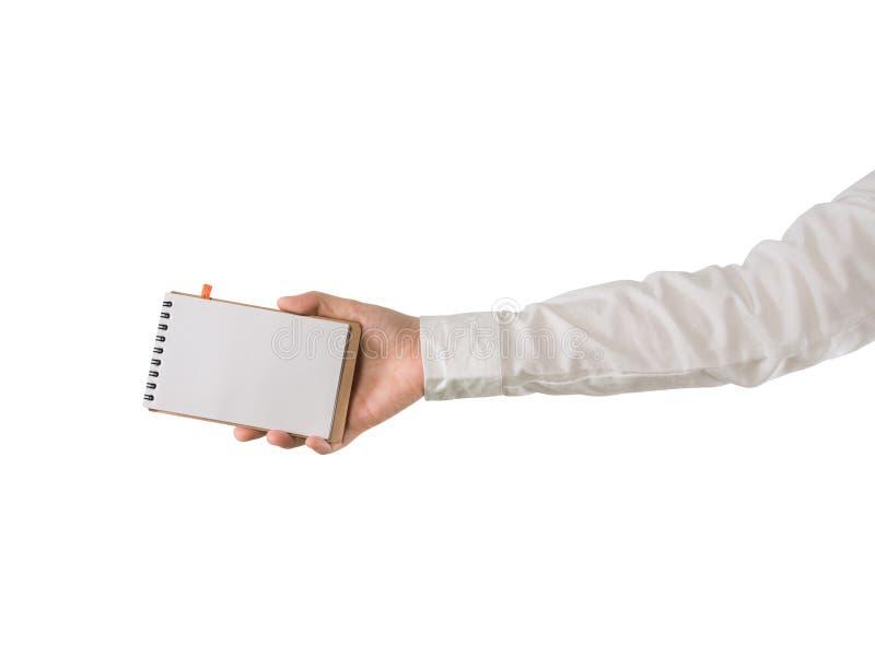 Menschlicher Handgriffleerer bildschirm auf Notizbuchpapier auf lokalisiertem weißem Hintergrund stockfoto