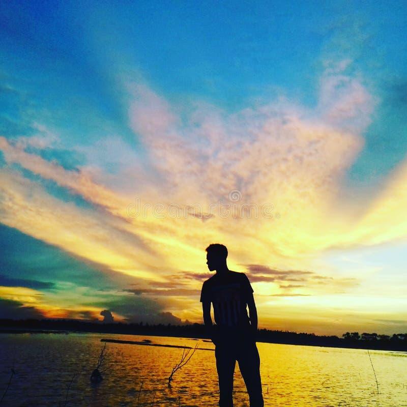 Menschlicher Schatten durch Himmel lizenzfreies stockbild