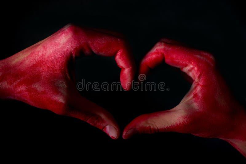 Menschliches Herz in der Hand lizenzfreie stockfotos
