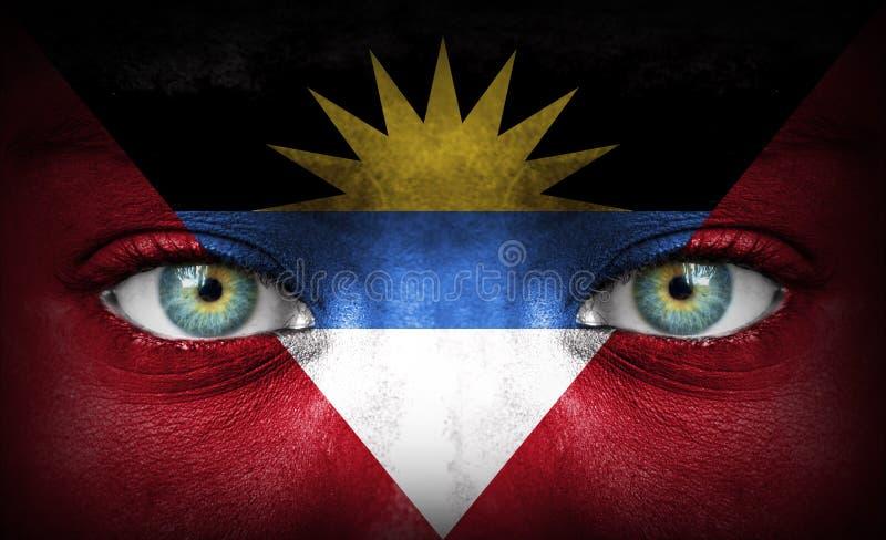 Menselijk die gezicht met vlag van Antigua en Barbuda wordt geschilderd royalty-vrije stock fotografie