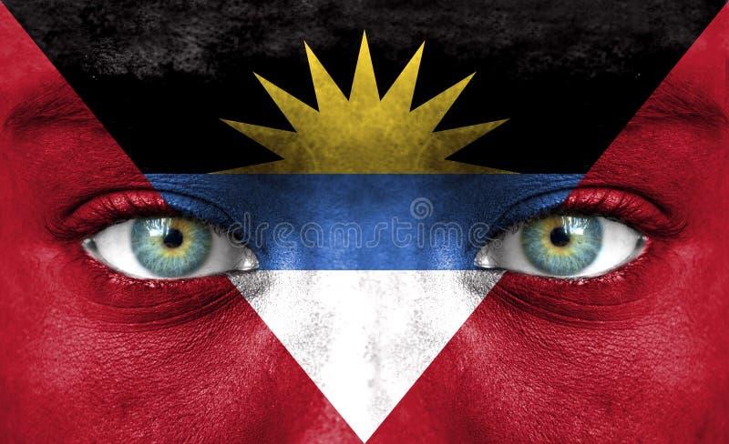Menselijk die gezicht met vlag van Antigua en Barbuda wordt geschilderd royalty-vrije stock afbeeldingen
