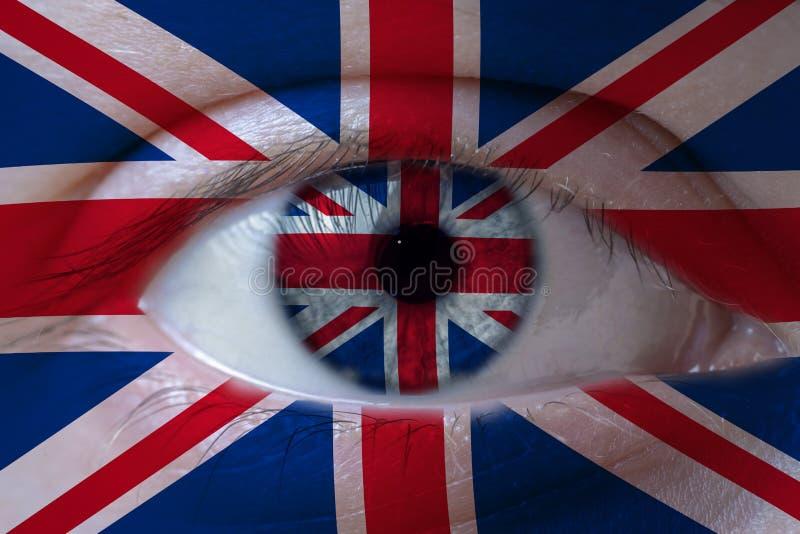 Menselijk die gezicht met vlag van het Verenigd Koninkrijk wordt geschilderd royalty-vrije stock fotografie