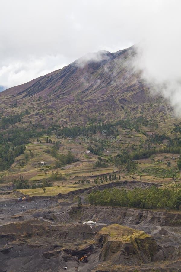 Menselijke activiteiten bij Vulkaan stock foto