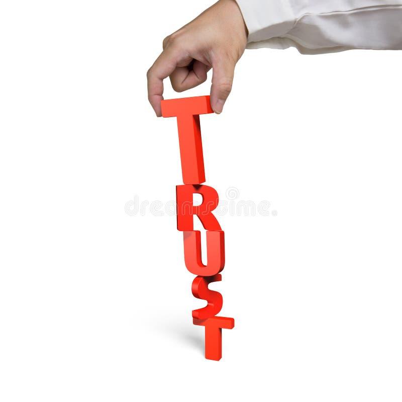 Menselijke hand die T voor vertrouwenswoord samenbrengen stock fotografie