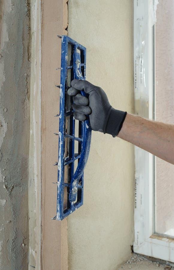 Menselijke hand met pleisterrasp royalty-vrije stock afbeeldingen