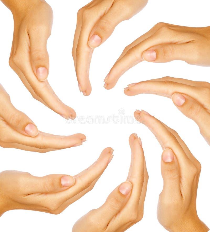 Menselijke handen die een cirkel met exemplaar-ruimte vormen stock afbeeldingen