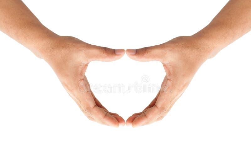 Menselijke handen die een hart vormen stock afbeelding