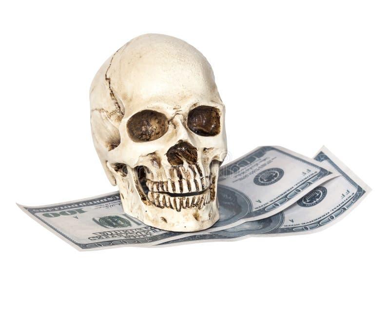 Menselijke schedel op dollarbok royalty-vrije stock afbeelding