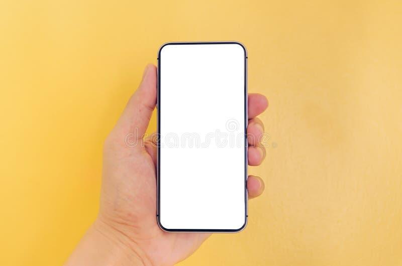 Menselijke smartphone van de handholding met witte het schermachtergrond royalty-vrije stock fotografie