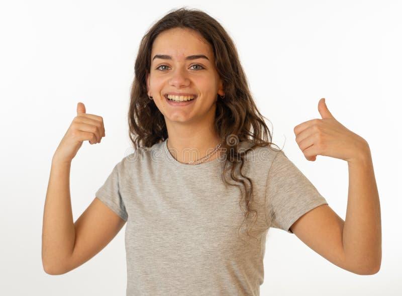 Menselijke uitdrukkingen en emoties Portret van jong aantrekkelijk meisje met het glimlachen gelukkig gezicht royalty-vrije stock foto's
