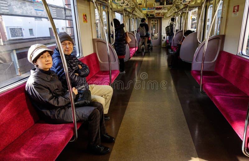 Mensen in de metro van JR in Tokyo, Japan stock afbeelding