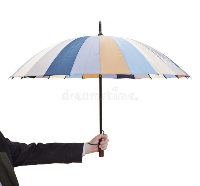 Mensen holdind open gestreepte paraplu stock fotografie