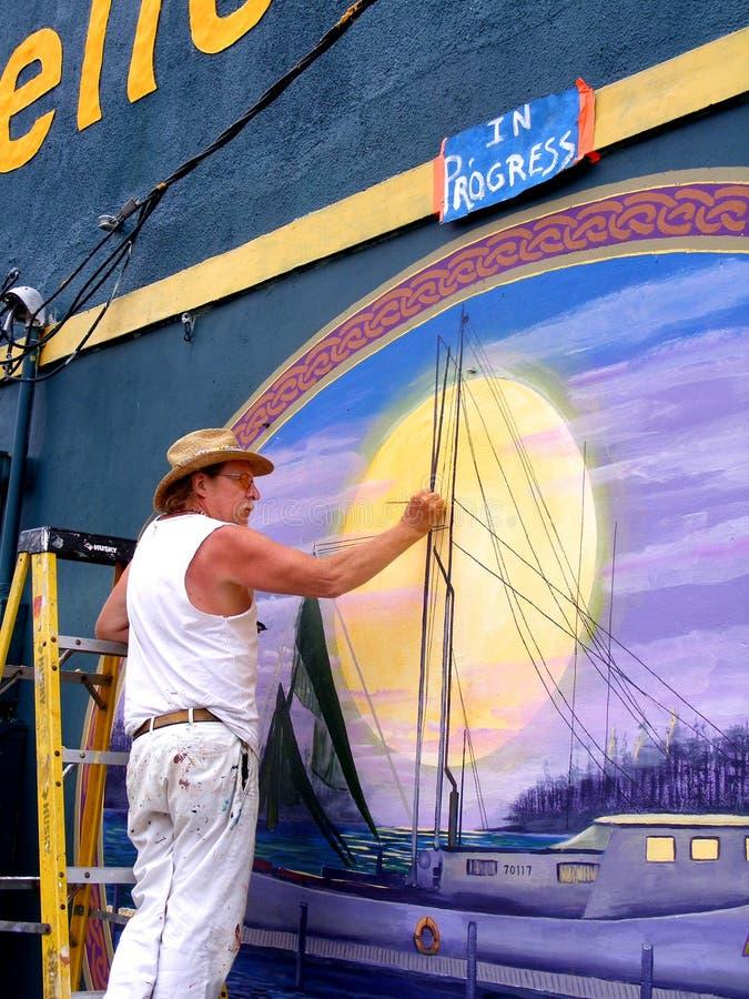 Mensen-kunstenaar het Schilderen Muur Buiten in New Orleans royalty-vrije stock foto