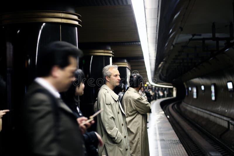 Mensen in metro stock afbeeldingen