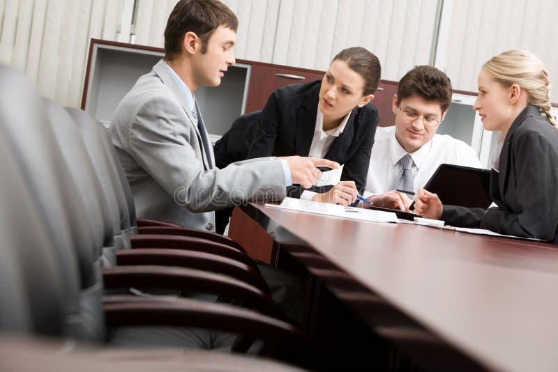 Mensen op vergadering stock afbeelding