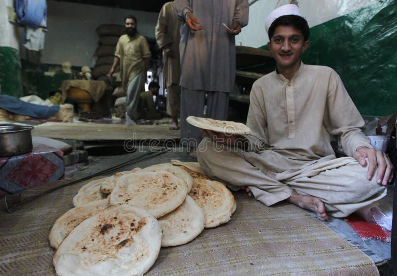 Mensen in Pakistan - het dagelijks leven stock afbeelding