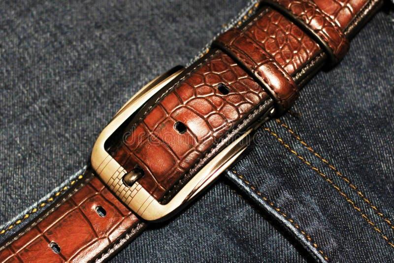 Mensen` s riem en jeansmanier stock afbeelding