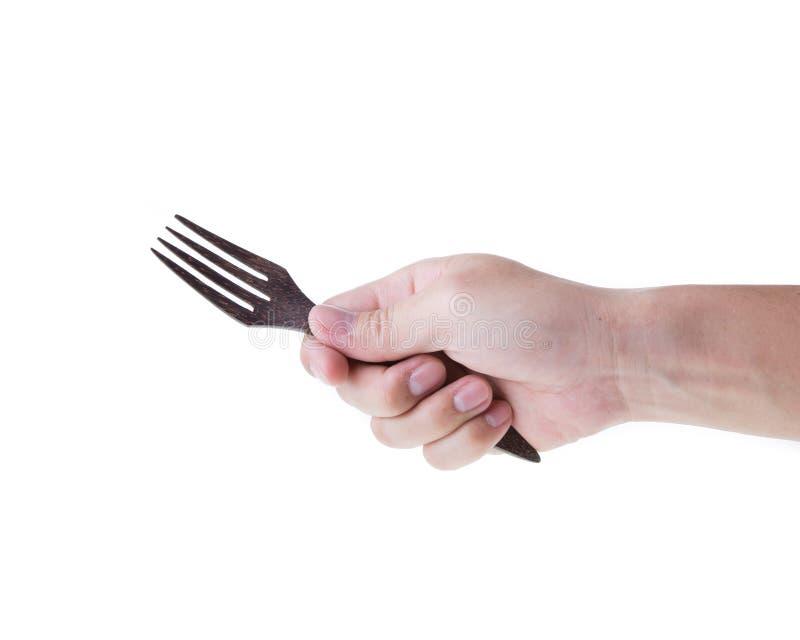 Mensenhand met vork stock foto's